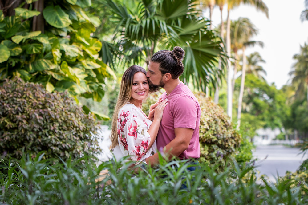 Engaged-Couple-Snuggle-In-Tropical-Foliage-in-Key-West.jpg