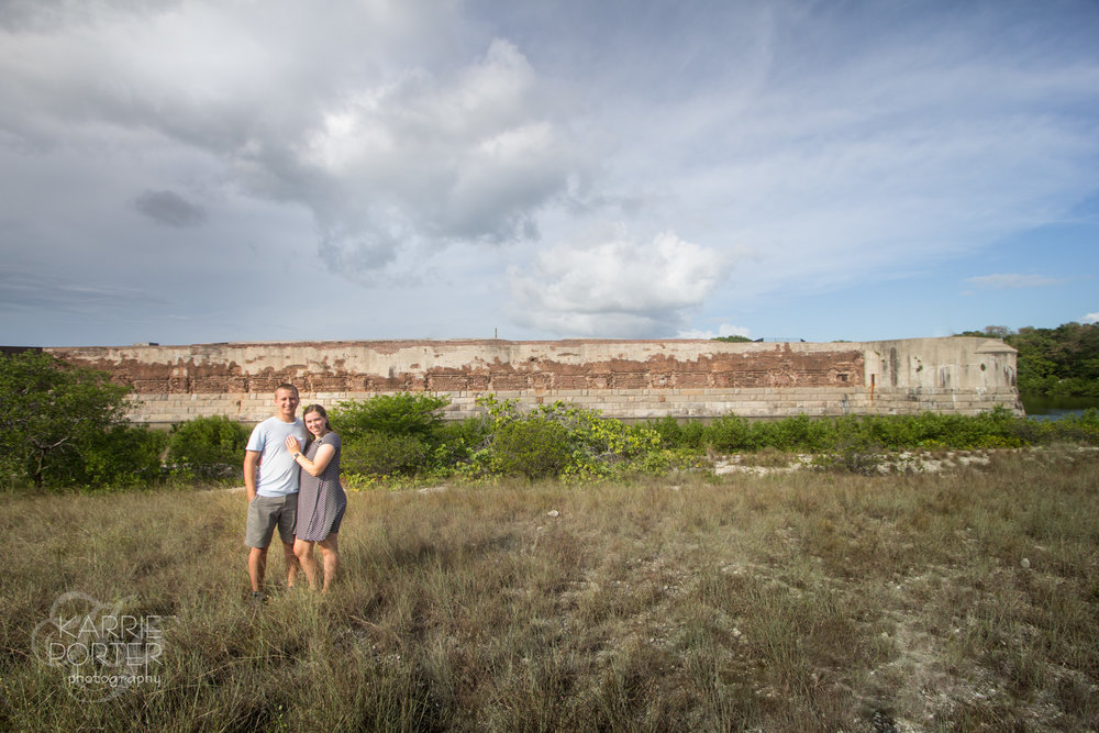 Couple pose with the fortress of Fort Zachary Taylor State Park behind them in Key West