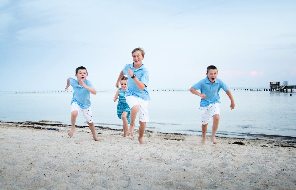 Group-Of-Kids-Running-On-Key-West-Beach-During-Family-Portrait-Session.jpg