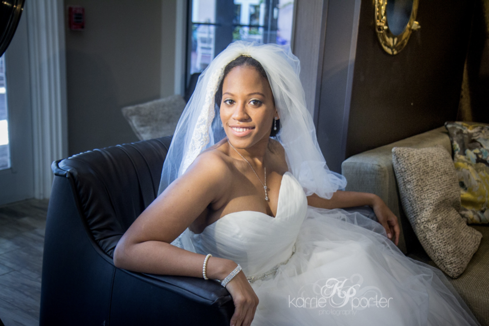 Bride-Poses-On-Chaise-Lounge-At-Doubletree-Resort.png