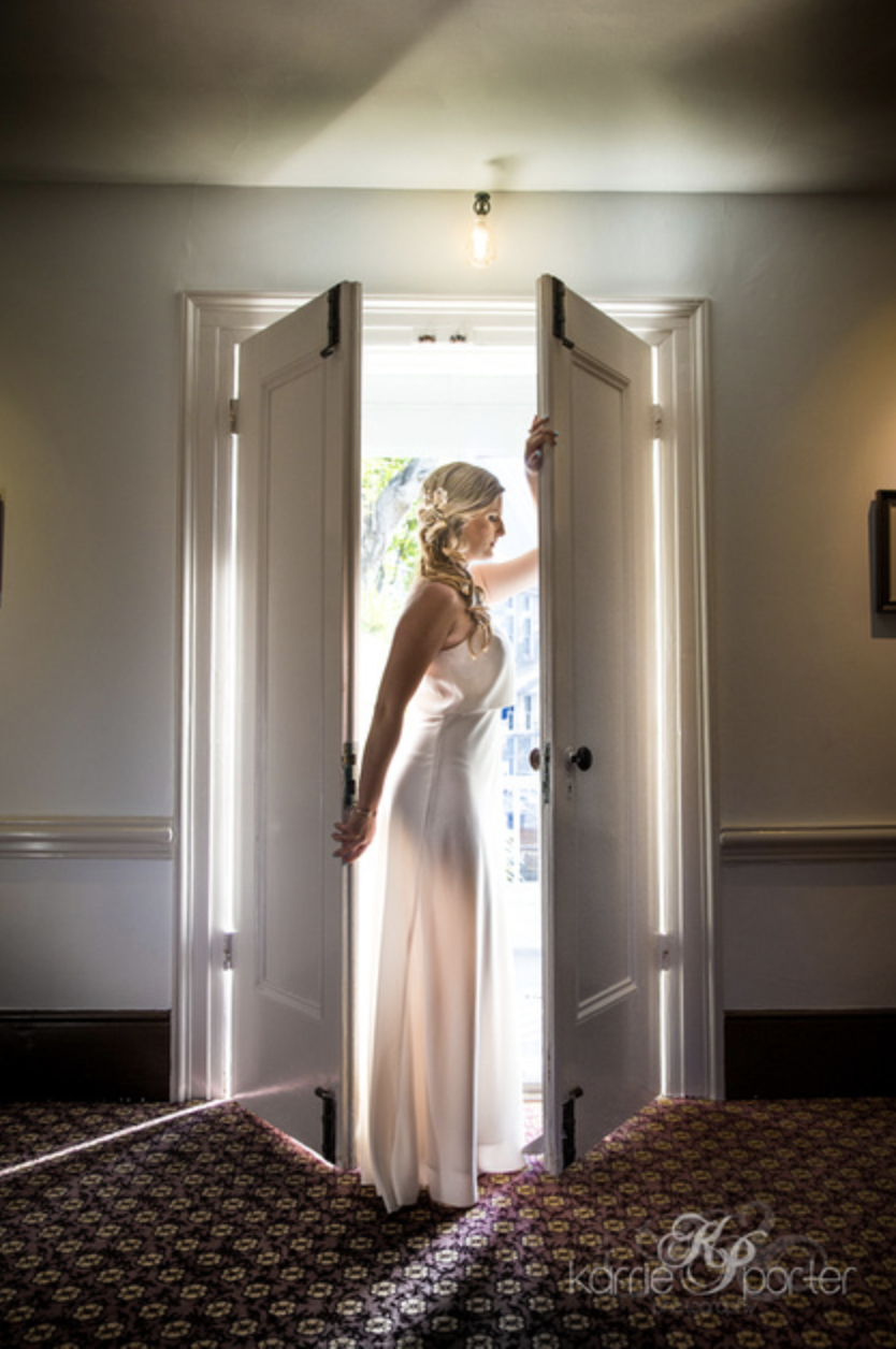 Backlit-Portrait-of-Bride-In-Doorway-Audubon-House.png