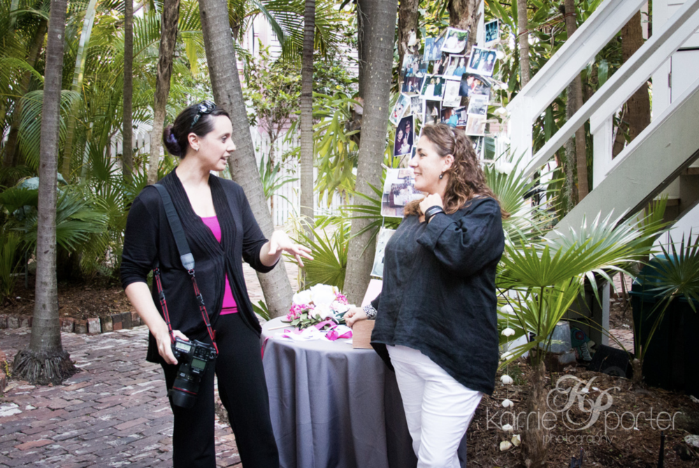 Local Key West Wedding Photographer Discussing With Planner from Simply You.png