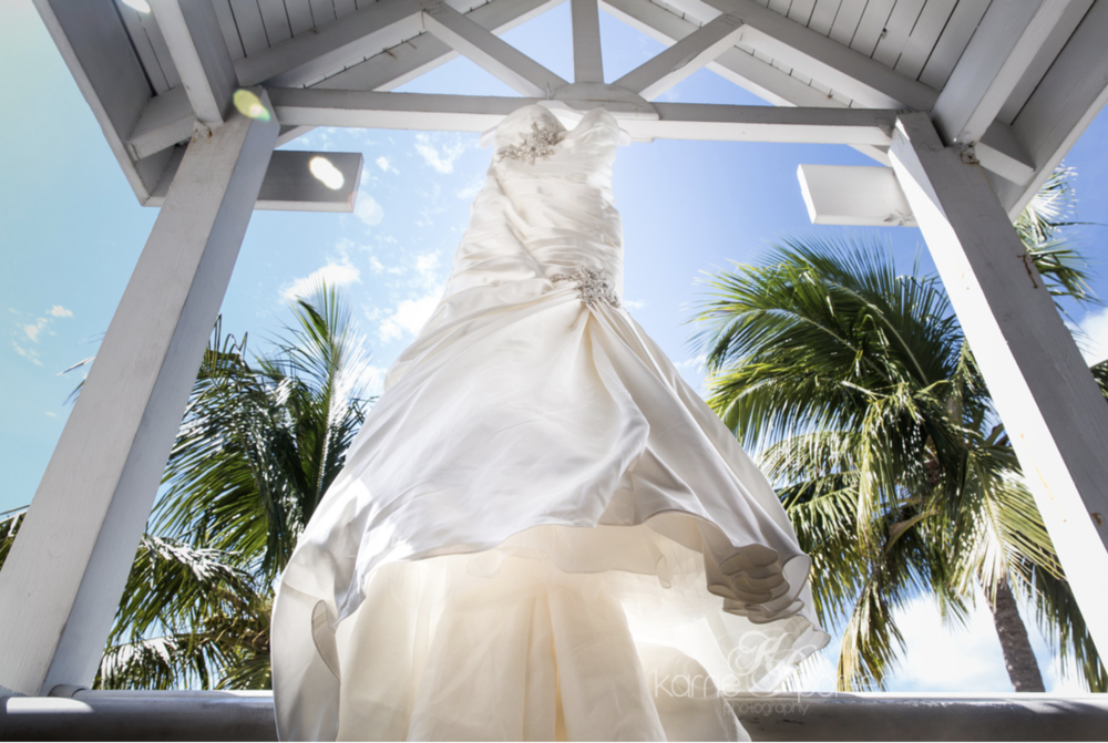 Wedding Dress Hanging in Key West Hotel Margaritaville Resort by Photographer Karrie Porter.png