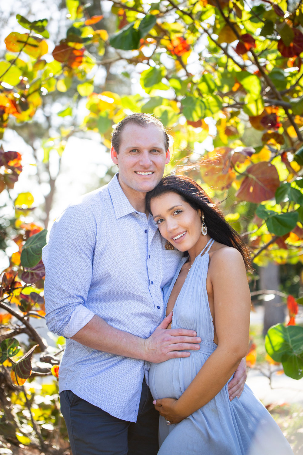 Beautiful maternity shot of couple under sea grape leaves in Key West