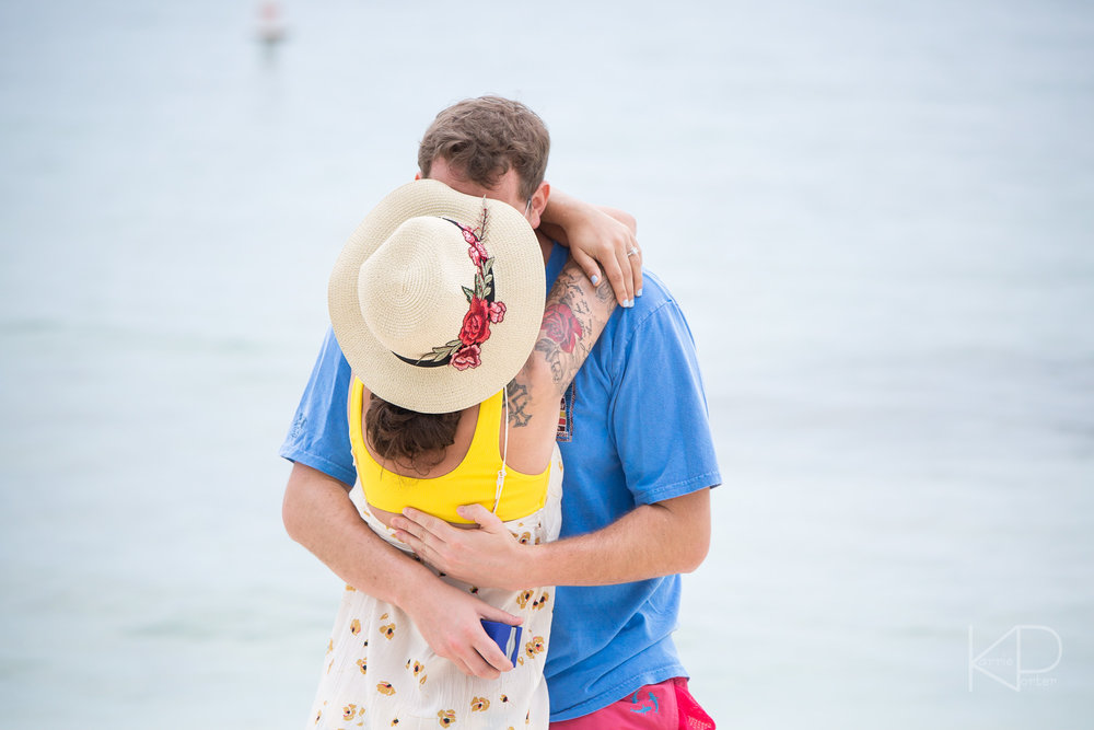 Couple gets engaged during undercover proposal photo shoot on Sunset Key private island at Crescent Beach off the coast of Key West Florida