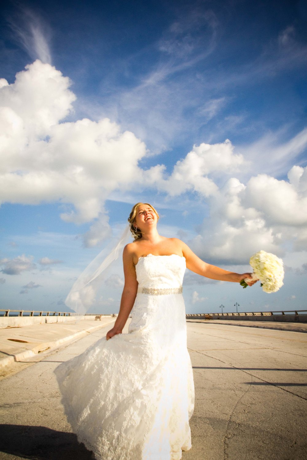 """Unscripted images like this cannot be """"posed"""". A bride who is not familiar being in front of the camera will need time to warm up to the idea of playing and laughing, not worrying about what's going on around her. Give yourself time to breathe and play on the wedding day."""