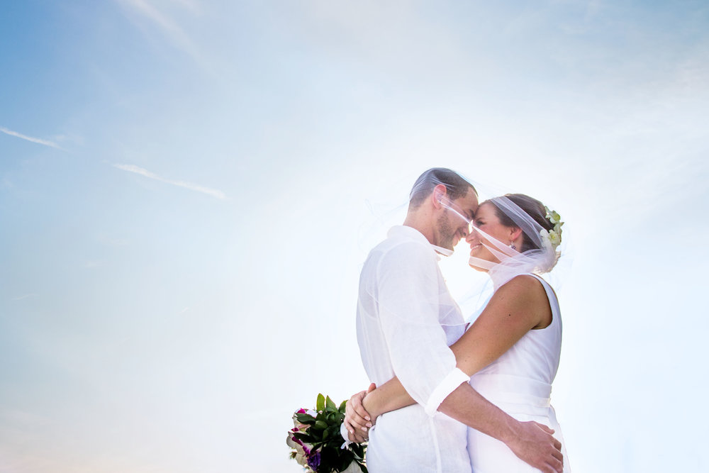 Bride and Groom Pose Forehead to Forehead on Beach in Key West
