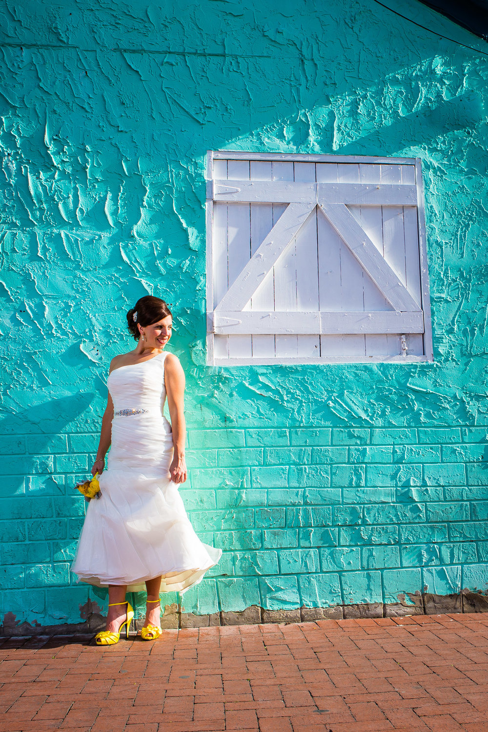 Bride Posing on Teal Blue Wall with Yellow Heels in Bahama Village Key West