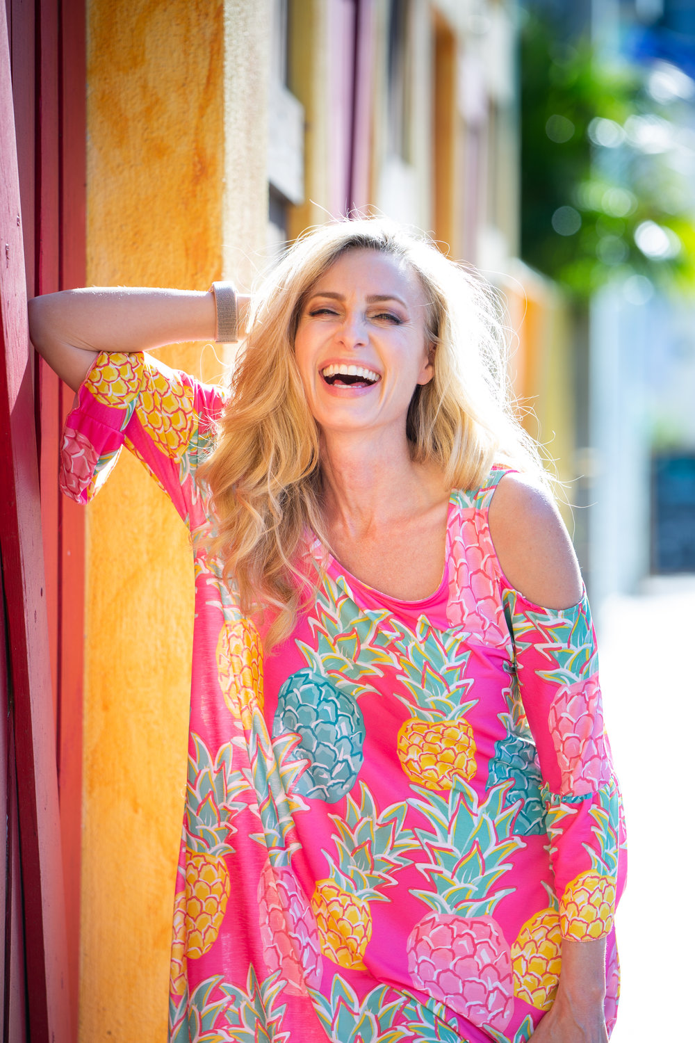 Model laughing in bright pink dress.jpg