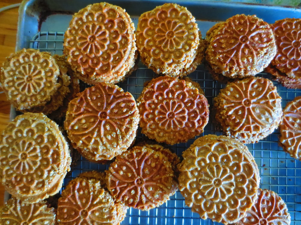 "Pizzelle cookies are a traditional Italian flat waffle cookie, whose name means ""round, small, flat"" deriving from the same root from which we get the word ""pizza"". If you happen to own a pizzelle iron, it's easy to make gluten-free variations. Pizzelles are a holiday favorite in my family and for the past several years I've secretly been making the cookies gluten-free. The switch is so seamless that no one noticed the change. Sorghum flour alone works well or use a blend (see recipe below). The classic recipe is made with bountiful anise seeds (I use many more anise seeds than the average recipe) and a good shot of vanilla extract. Lately, I've been making sesame pizzelles and then making a sandwich cookies with two sesame pizzelles filled with a raw sesame caramel. The chocolate version is equally addictive and is great paired with hazelnut butter. Pizzelles last well stored in an airtight container and are easy to transport making them perfect for picnics and summer car trips.      Gluten-free Sorghum Flour Blend:   I like to use this blend where I would use whole wheat flour. It has a hearty slightly nutty taste.  In a medium bowl, combine:   2 C sorghum flour    2/3 C potato flour    1/4 C +2 tsp tapioca flour    1 tsp xanthan gum   Whisk flours together until well combined. Store in an airtight container until use.      Gluten-free Anise Pizzelles:    1/2 C butter, melted (or coconut oil)    3/4 C coconut sugar    3 eggs    1 T vanilla extract    2 C gluten free flour mix (see recipe above)    1/2 tsp salt    1/2 C anise seeds       Gluten-free Chocolate Pizzelles:    1/2 C butter, melted (or coconut oil)    3/4 C coconut sugar    3 eggs    1 T vanilla extract    13/4 C gluten free flour mix (see recipe above)    1/2 tsp salt    1/2 C cocoa powder"