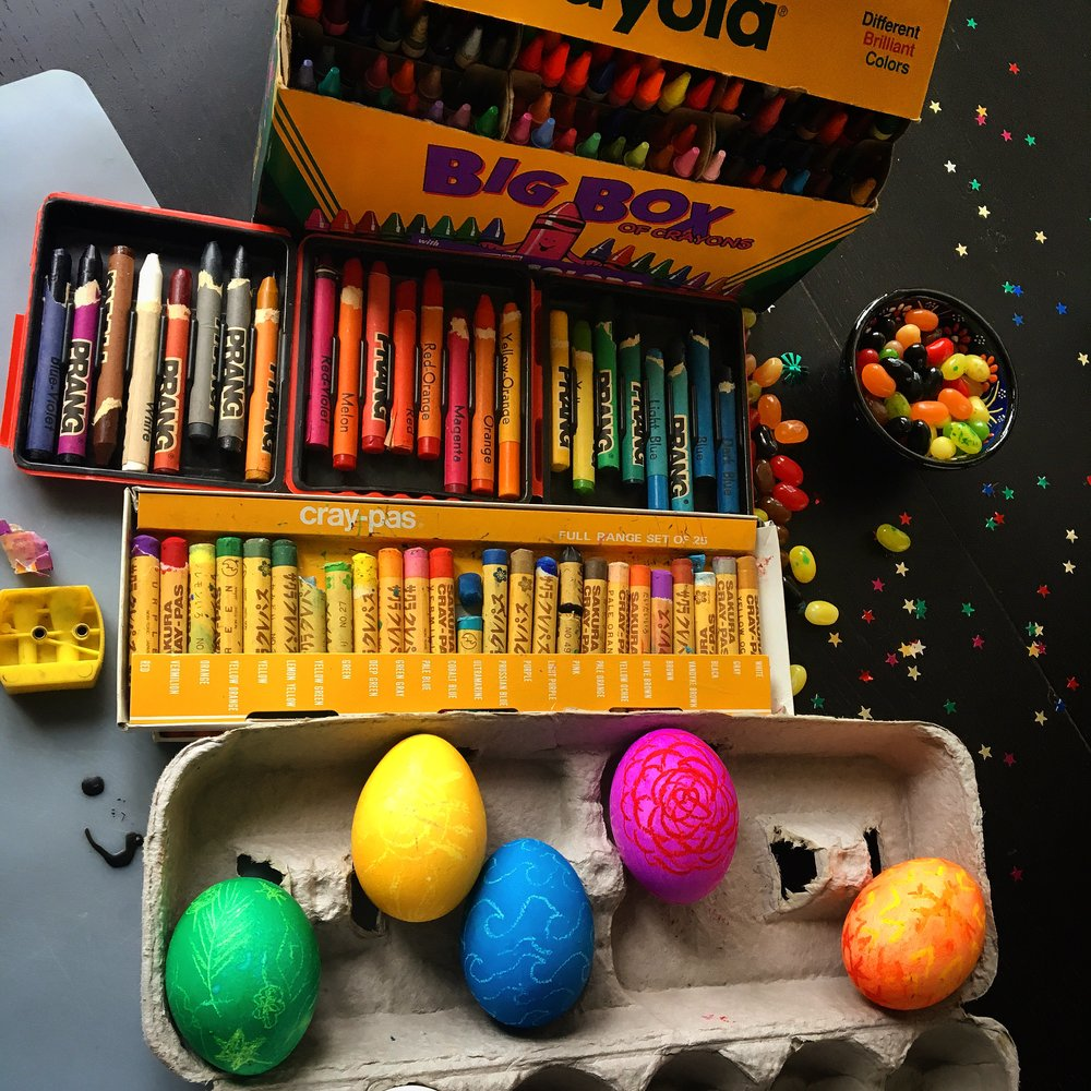 Playing around with egg decorating for kids, I found pastels are the best crayon for decoration, shown in the pink and orange eggs.