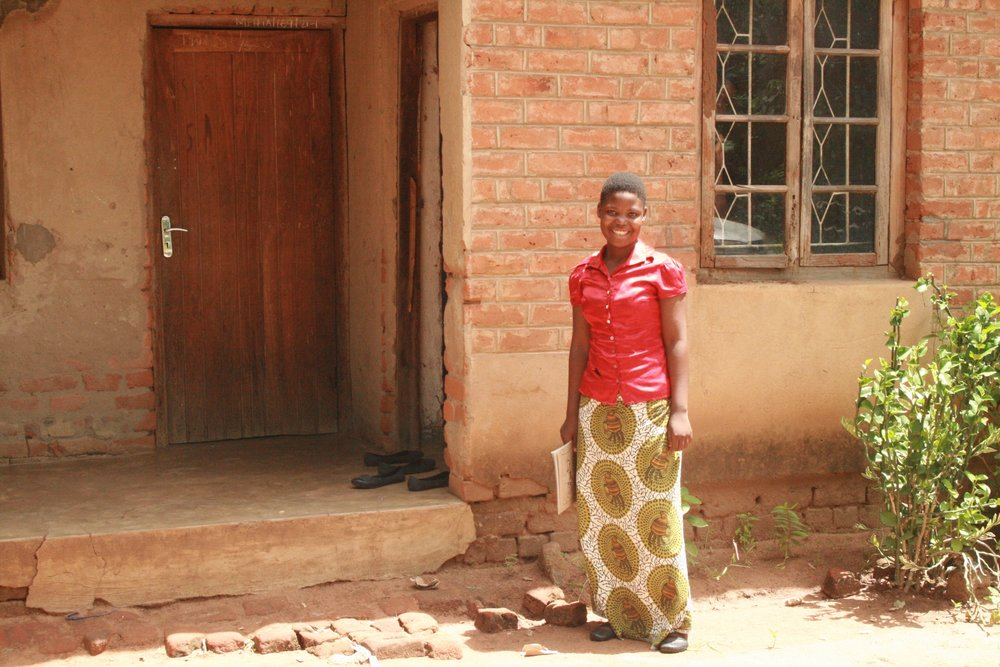 Chikondi, during her Form 2, standing near her dormitory less than 1 kilometer from the school.