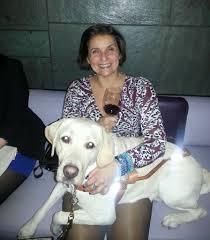 Alex and Hogan, her first seeing-eye dog.