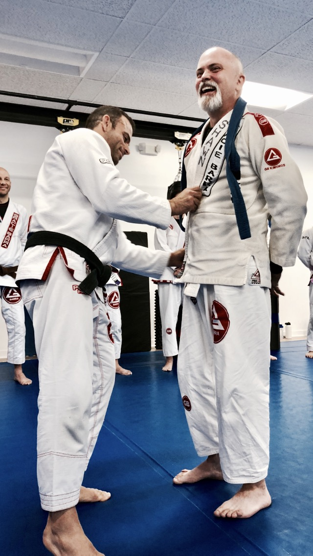 "That moment you laugh  when your professor, your mentor, your brother calls you out on shirking your deeper responsibility toward your own journey.    ""You've been dodging this moment my brother"", he said in not so many words, ""you've been complacent as a blue belt, it's made you lazy and soft.  you have responsibilities, let me help you with that.""   -Prof. Carlos LEmos Jr. (4x World, BRazilian, European, American & Pan-am Champion)             Gbdownersgrove.com"