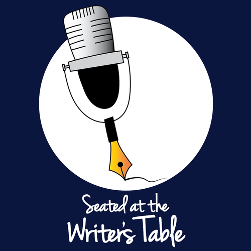 seated at the writers table.png