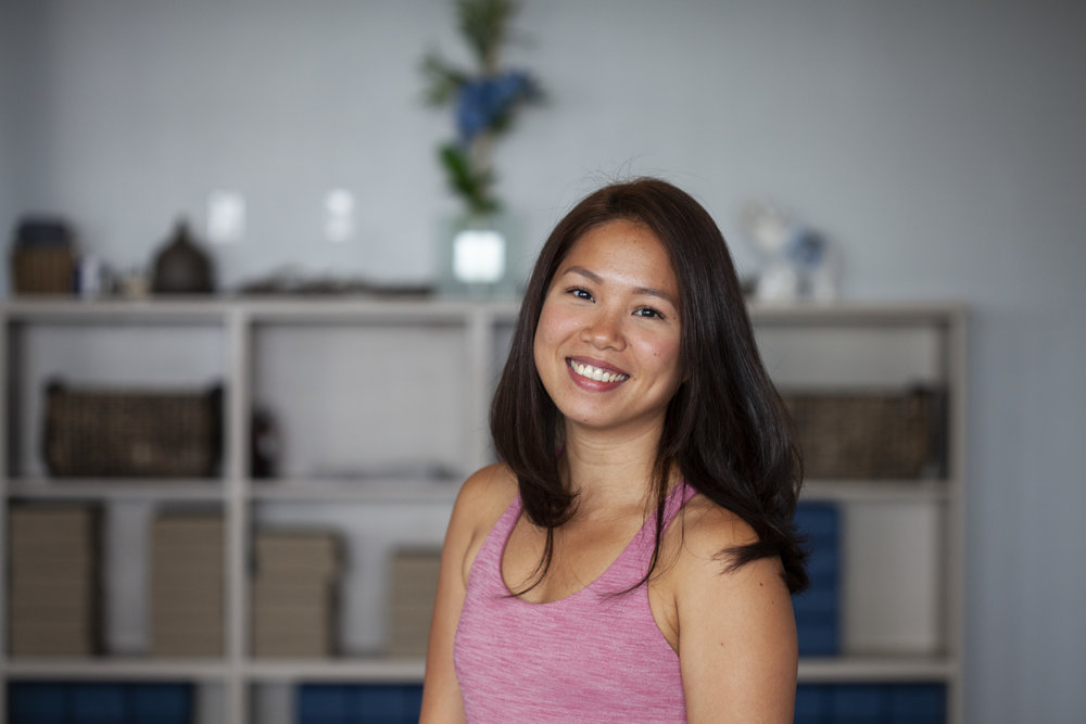 """Nikki is a dedicated yogi with specialization in Vinyasa flow, a national athlete and student of sports science. She looks to share her passion for holistic wellbeing with the world.  Nikki comes from a strong sporting background playing volleyball, basketball and touch football for high school and university in the Philippines. She also completed her diploma in Sports Science from the University of the Philippines in 2007. In 2010, she started playing rugby union and was selected to represent the Philippine Women's Rugby Team (The Lady Volcanoes) from 2010 to 2015. She then transitioned to playing for the Philippine Women's Touch Football National Team as a less impact sport and represented her country in the Touch Football World Cup in Australia in 2015. She discovered yoga in 2010 to compliment all of her rigorous sporting activities and initially thought of the practice as a nice stretching session to help in the rehabilitation of her evermore frequent injuries. In 2014 she began working for the New Zealand Embassy, meeting deadlines and quota's and with injuries hampering her sporting progress she began yearning her next challenge. As her practice became a more extensive part of her life, she started to develop a sense of connection and wholeness with yoga and its fundamental teachings.  In 2017 Nikki and her husband moved to Edmonton for his work and it was then that her practice became a consistent daily activity and she has not looked back since. She completed my 200 hour yoga certification in Ubud Bali earlier this year. You could say that she tried hard to find yoga but in the end yoga found her. She now relishes the opportunity to impart this passion and knowledge acquired to everyone, as well as learning more as a forever student of yoga """""""