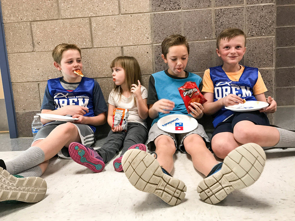 The Willis' (Tau's parents) were kind enough to throw a pizza party after the game. This is Jude and his buddies hanging out and eating pizza. Left to right: Cooper, Rylee, Jackson and Jude.