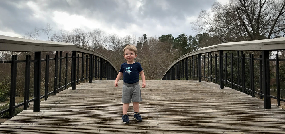 Max on a bridge at Pullen Park.