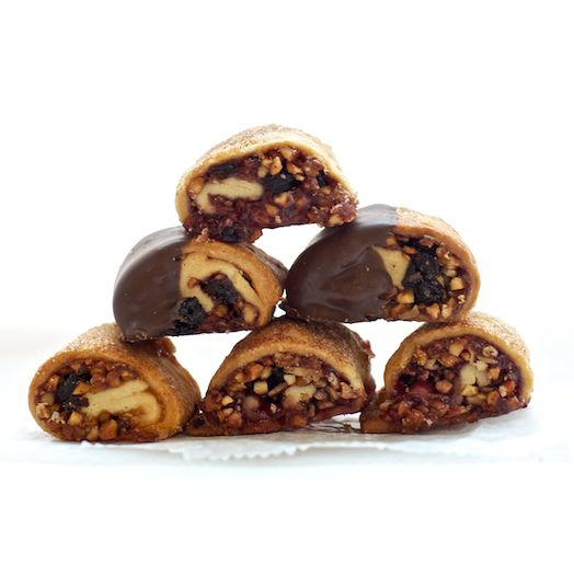RUGELACH  An old-world treat. Buttery cookies rolled with nuts, fruit preserves and chocolate.