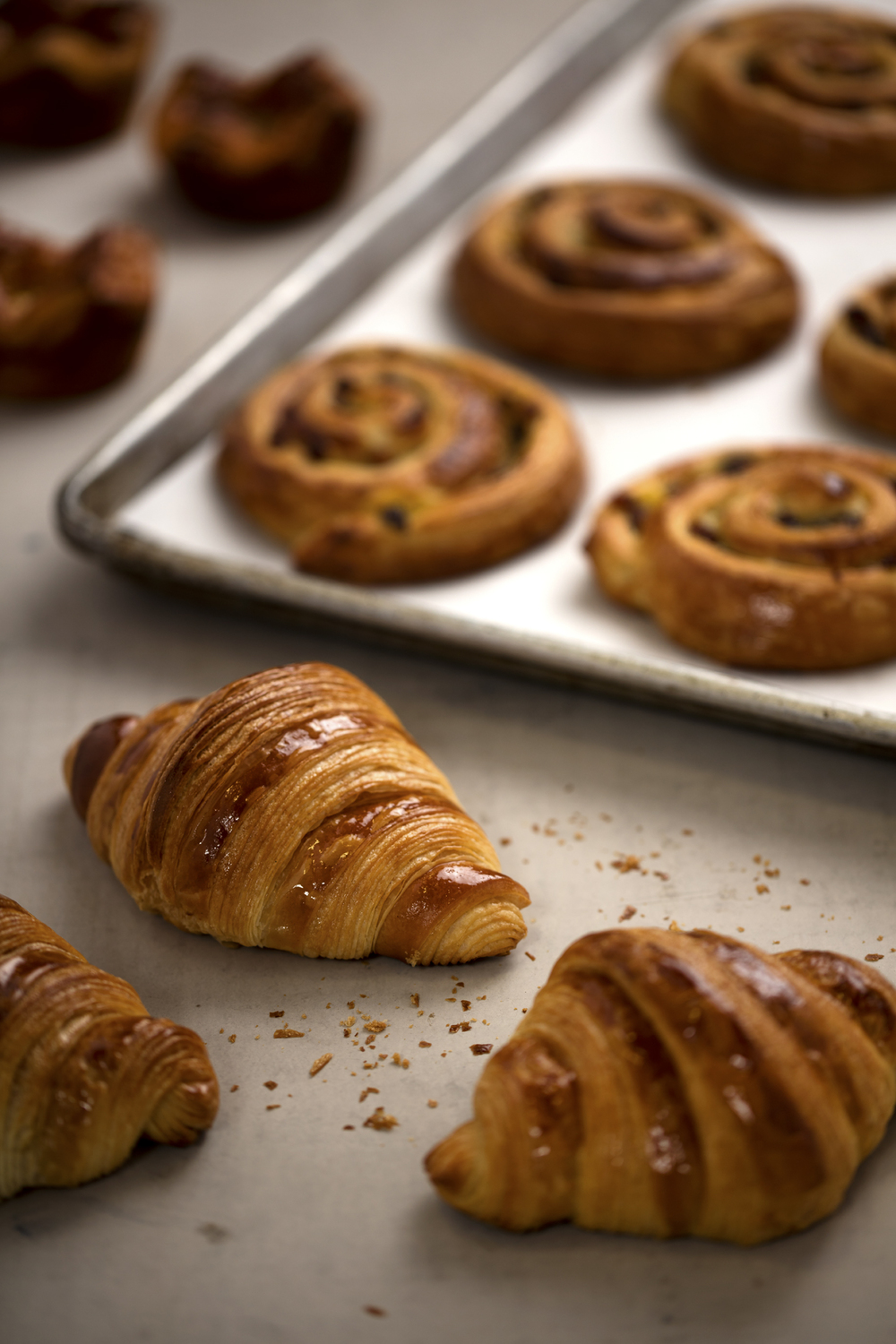 CROISSANTS  Baked daily in-house, our croissants are moist and buttery with a tender, flaky crust. A true taste of Paris.