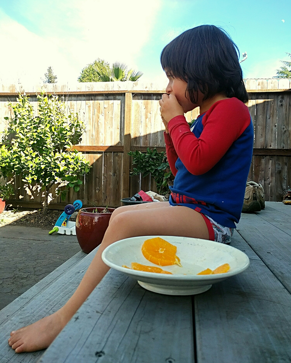So warm Kamal decided he'd eat his orange outside. In his underpants.