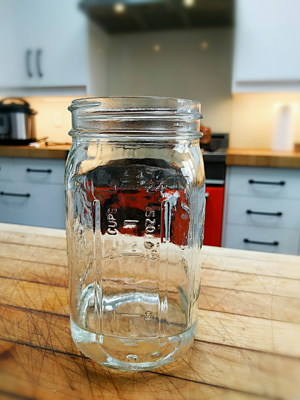My water glass is a quart Mason jar. Four of these=one gallon.