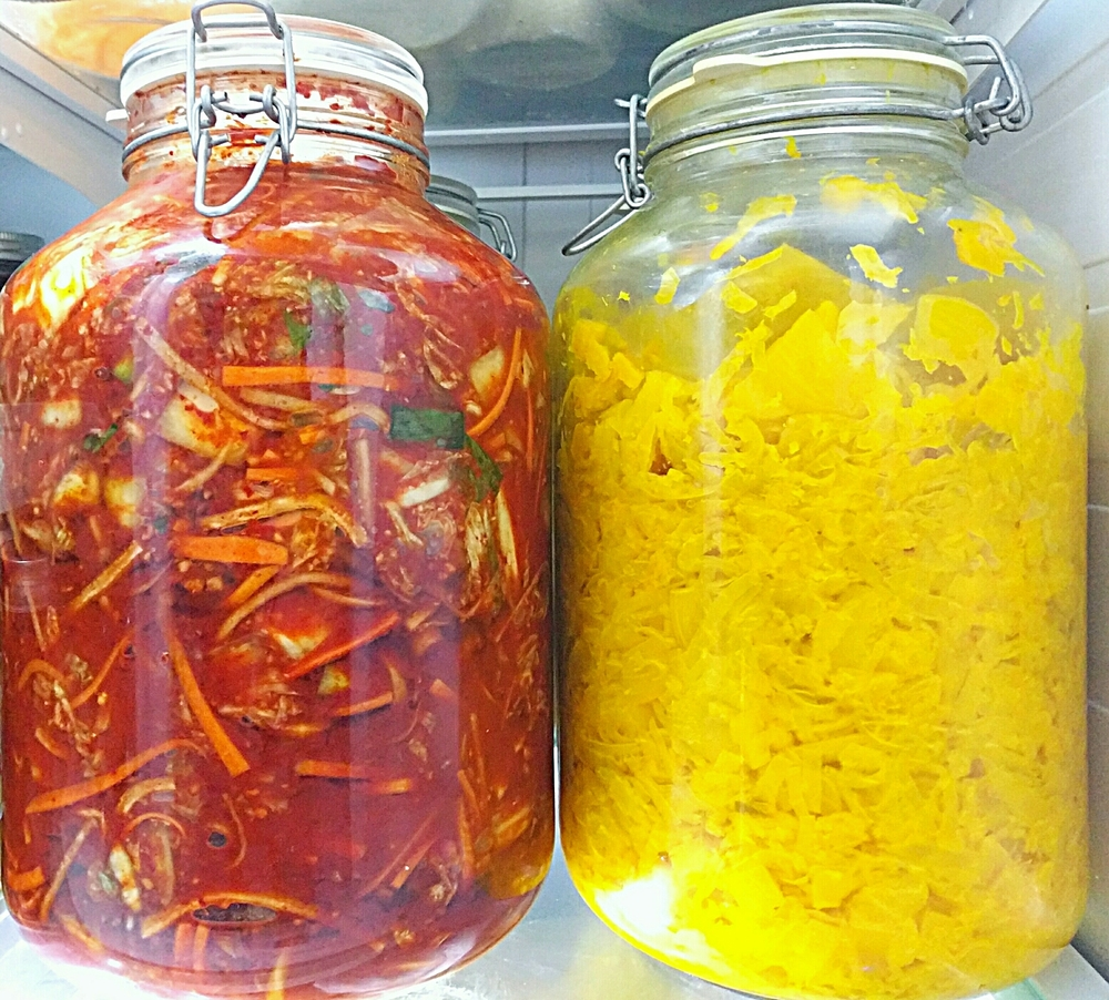 Left to right: Adam's fabulous kimchi; Adam's superyellow pineapple-turmeric sauerkraut
