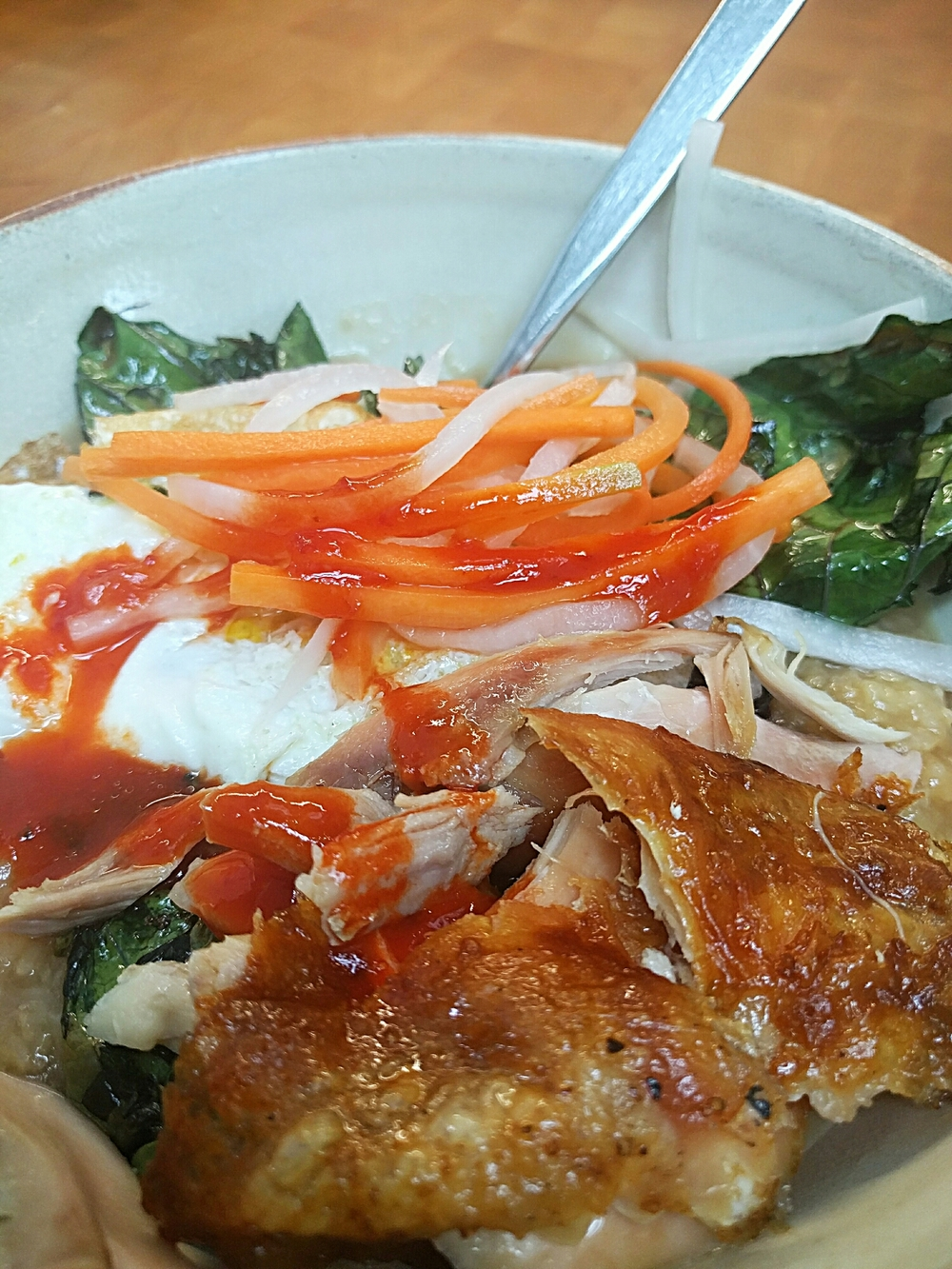 Jasmine rice, roast chicken, daikon and carrot pickle, over-easy egg, tree collards