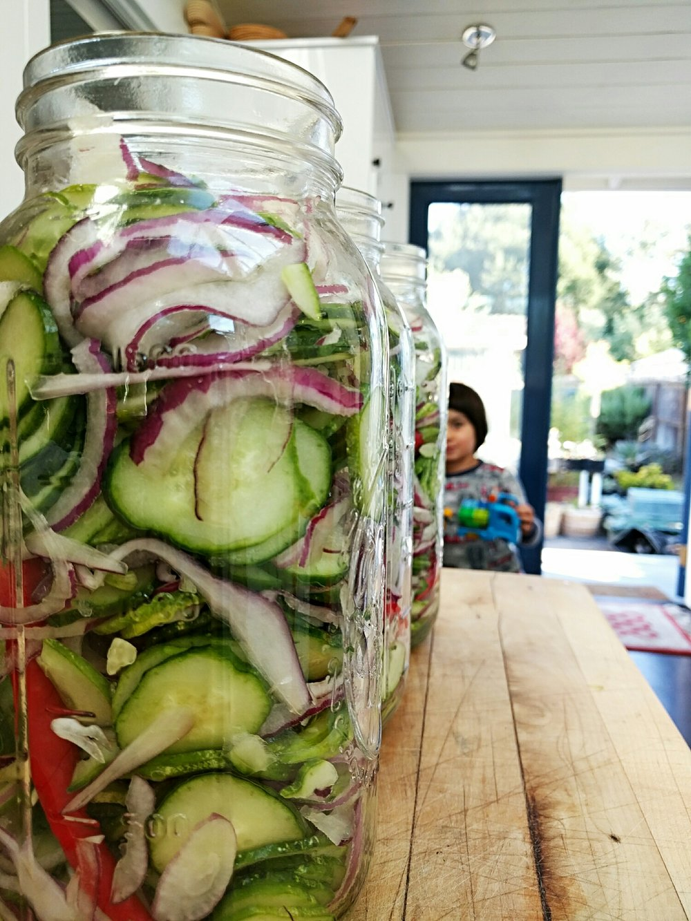 Sliced cucumber mixture just before pouring brine into jars