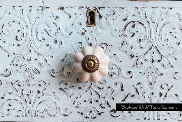 "This is the front of a dresser that blogger ""Orphan's with Makeup"" created with Country Chic Embossing Plaster. It looks amazing!"