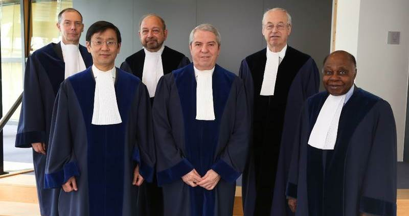 The ITLOS Special Chamber in the pending case between ghana and   Côte d'Ivoire. l to r: Mr. gautier (registrar), judge paik (south korea), icj president abraham (appointed by   Côte d'Ivoire), special tribunal president bouguetala (algeria),   judge Wolfrum (germany), former itlos president mensah (appointed by ghana).   CREDIT: ITLOS, https://www.itlos.org/cases/list-of-cases/case-no-23/case-no-23-provisional-measures/.