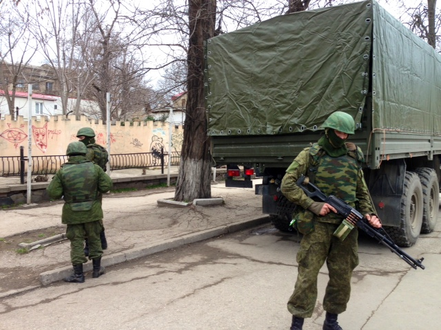 Unmarked Soldiers in Simferopol, 2 March 2014.   credit: By Elizabeth Arrott [Public domain], via Wikimedia Commons.