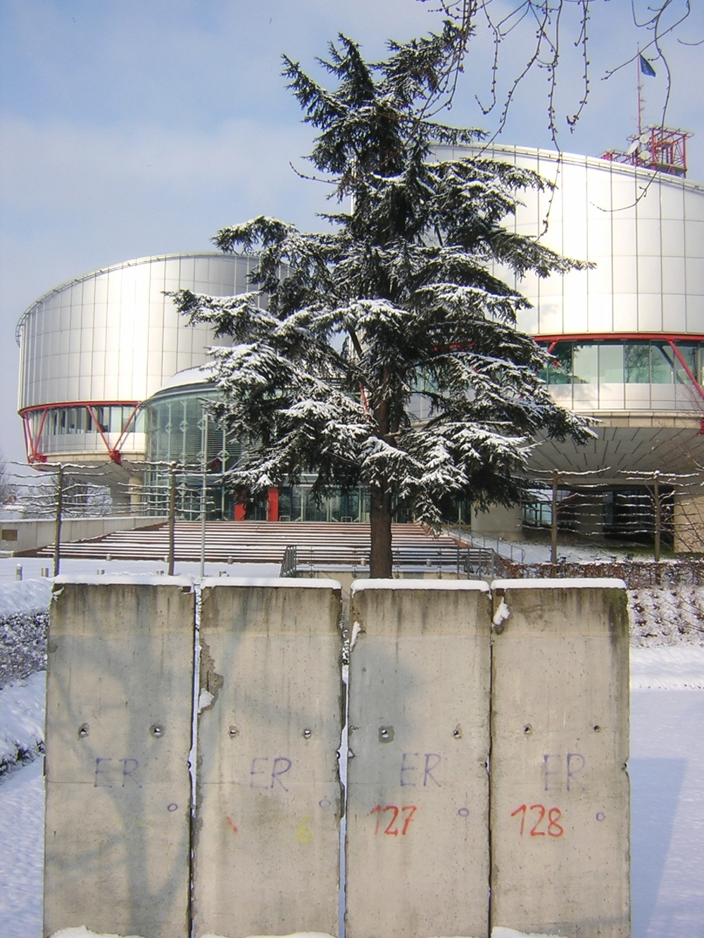 A remnant of the berlin wall placed in front of the european court of human rights in strasbourg.   credit: By francois from Strasbourg, france [CC BY 2.0 (http://creativecommons.org/licenses/by/2.0)], via Wikimedia Commons.