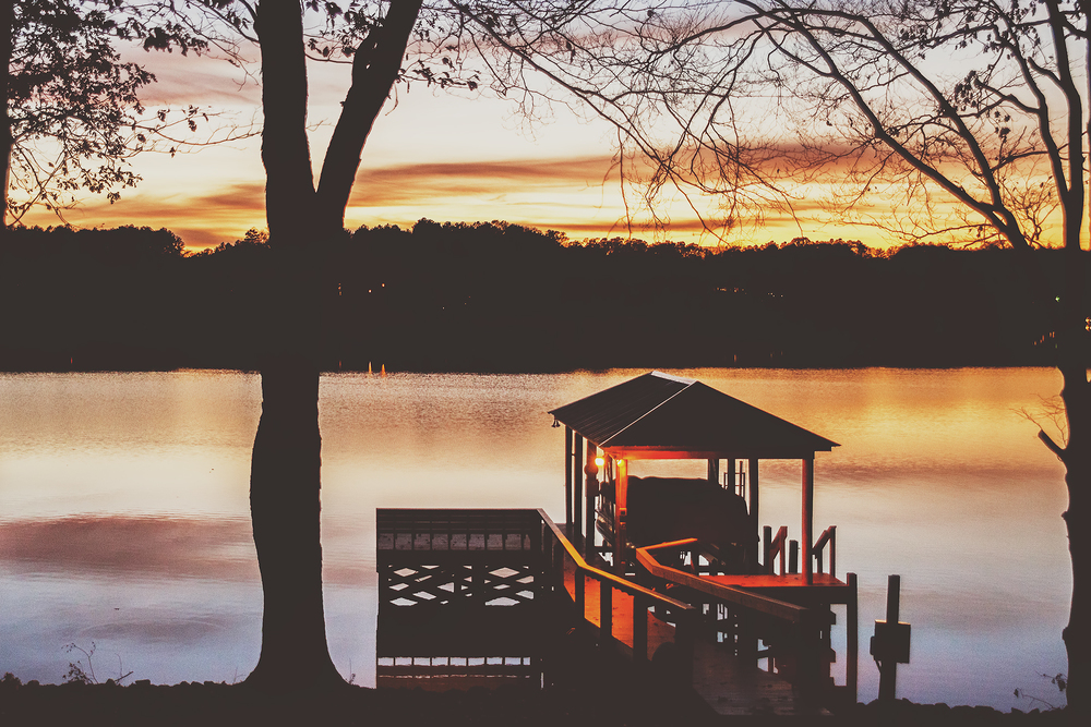 boat dock basking in the glow of the sunset on lake wylie