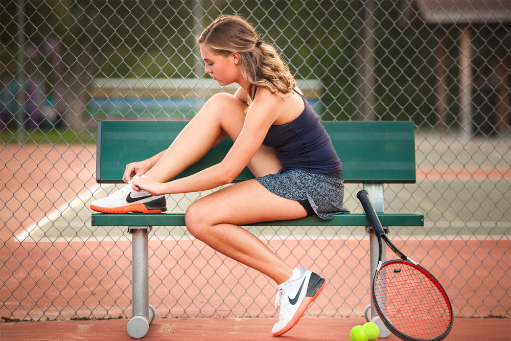 tying-shoe-on-tennis-bench.jpg