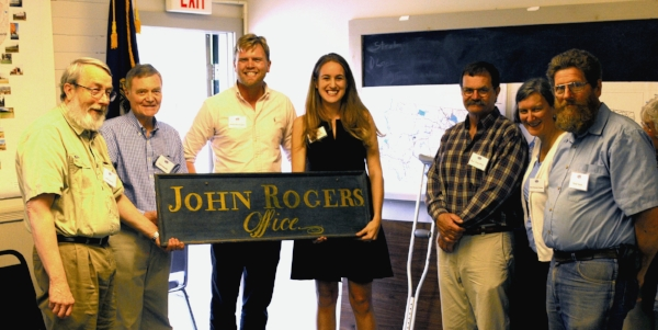 Presentation of 200-year old office sign of Attorney and Rogers House builder, John Rogers.  Left to right, John Adams, Chair, Orford Selectboard; Carl Schmidt, Orford Historical Society; new Rogers House owners, Jared and Elise Henningsen; Paul Goundry, Selectboard member; Anne Duncan Cooley, former Selectboard Chair; David Smith, Selectboard member.   Photo by Ted Cooley.