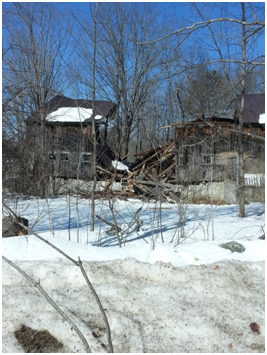 The roof and walls of the original barn collapsed after a heavy snowfall.