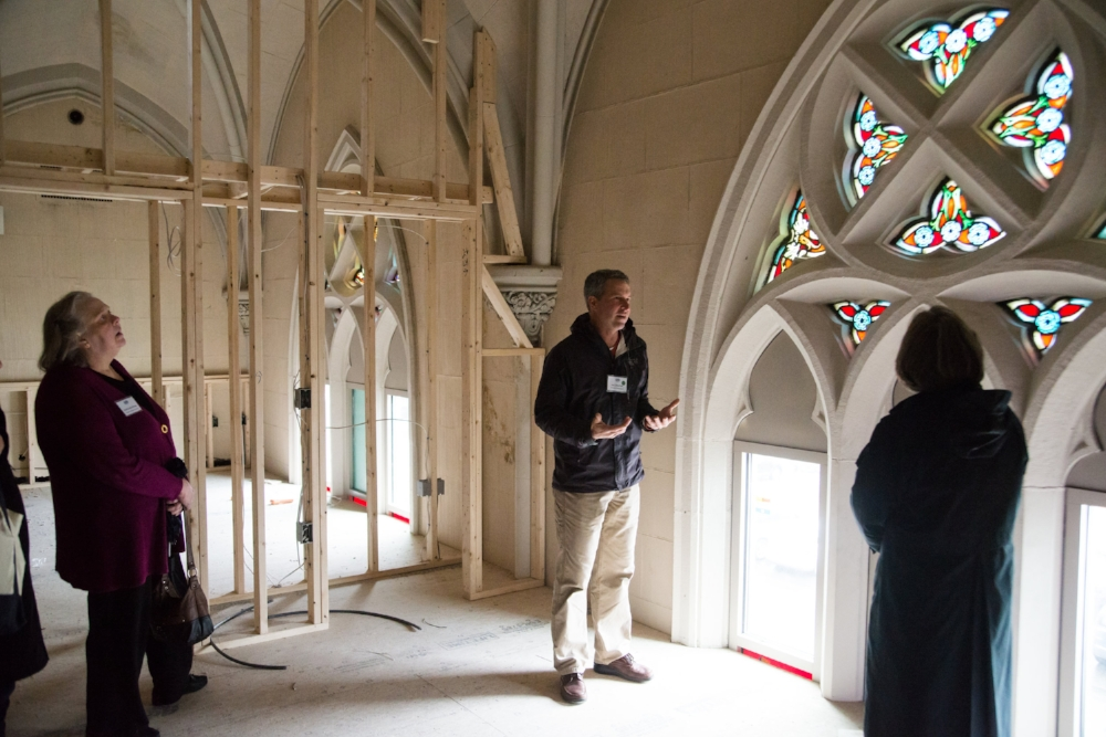 Developer Jon Chorlian leads tours through the Sacred Heart Church on Pleasant Street, which was being converted into condo units.  Photo: Steve Booth