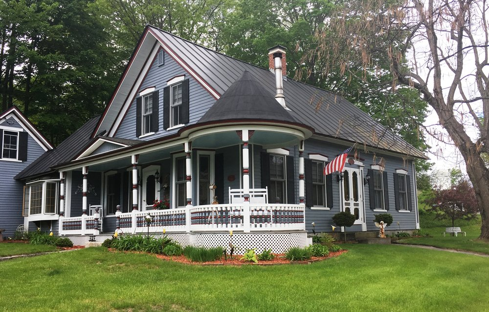 This house in Enfield Center has a Victorian-era porch added to an otherwise Greek Revival cape.