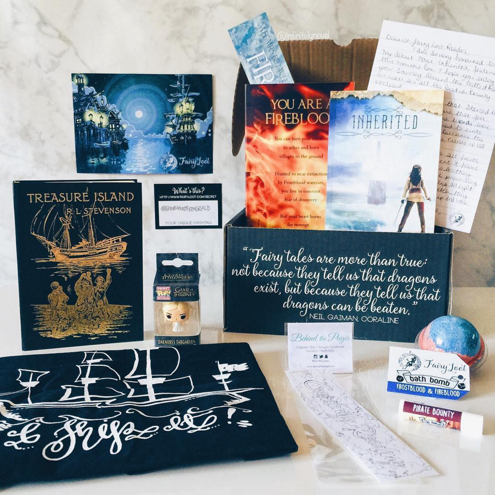 PIRATES & POWER - JULY 2016IMAGE BY@INFINITELYNOVELInherited by Freedom Matthews (signed and personalised)Personalised letter and postcardARC of Frostblood by Elly Blake and bookmarkExclusive Frostblood & Fireblood Bath Bomb (Geeky Clean)Exclusive Pirate Bounty Lip Balm (Geeky Clean)Jon Snow or Daenerys Targaryen Pop KeyChain (Funko)Treasure Island or Articles des Voyages Notebook (Museums)Currently Reading Colouring in Bookmark (BehindThePages)Exclusive I Ship It Tote Bag (Alice in Wonderbookland)WATCH BRITT'S UNBOXING VIDEO