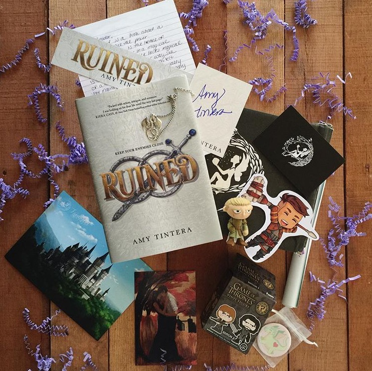 HIGH FANTASY - MAY 2016IMAGE BY @LIFEANDLITERATURERuined by Amy TinteraSigned bookplate, bookmark, personalised letter and art cardExclusive Dragon Bracelet (MyClockworkCastle)Pastel Dragon Pocket Mirror (MelissaNettleship)Dragon Age Chibi Sticker (SparksCrafts)Game of Thrones Mystery Mini Funko (Funko)Minimalist Legolas Poster (FairyLoot)WATCH BEN'S UNBOXING VIDEO