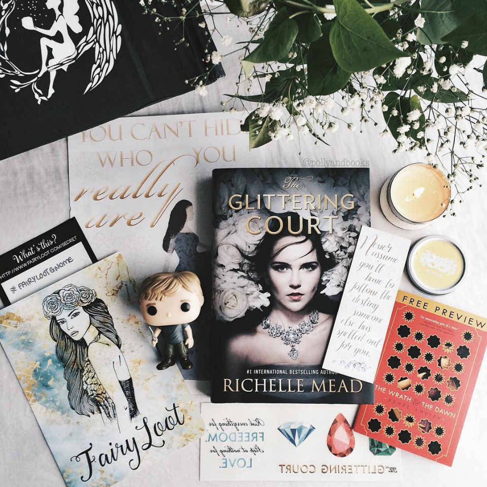 INTRIGUE - APRIL 2016IMAGE BY @POLLYANDBOOKSThe Glittering Court by Richelle MeadThe Glittering Court Temporary TattoosThe Wrath & The Dawn SamplerHunger Games Pop Vinyl Funko (Funko)Glittering Court Bookmark (FairyLoot)Exclusive Glittering Court Poster (BehindThePages)Exclusive Vanilla Bean Candle (FairyLoot)WATCH CASEY'S UNBOXING VIDEO