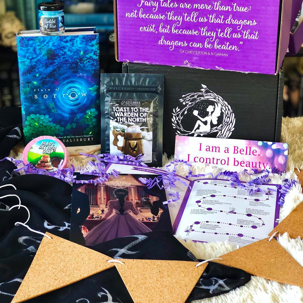 MEMORABLE MOMENTS - MARCH 2018IMAGE BY @READITANDWEEP_GIRLSExclusive hardcover edition of State of Sorrow by Melinda SalisburySigned bookplate and letter from the authorExclusive Goblet of Fire Candle by Paperflames Candle CoToast to the Warden of the North by EponineExclusive Bilbo's Birthday Cake by Geeky CleanCork Flag Bunting by PaladoneExclusive Shadowhunter Rune Scarf by Fictiontea DesignsBonus items: The Belles bookmark and button