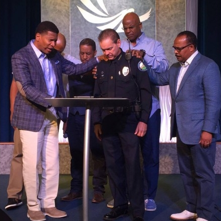 Pastor Lee Jenkins and Eagle's Nest elders praying for Police Chief Grant during the height of racial tensions this summer.