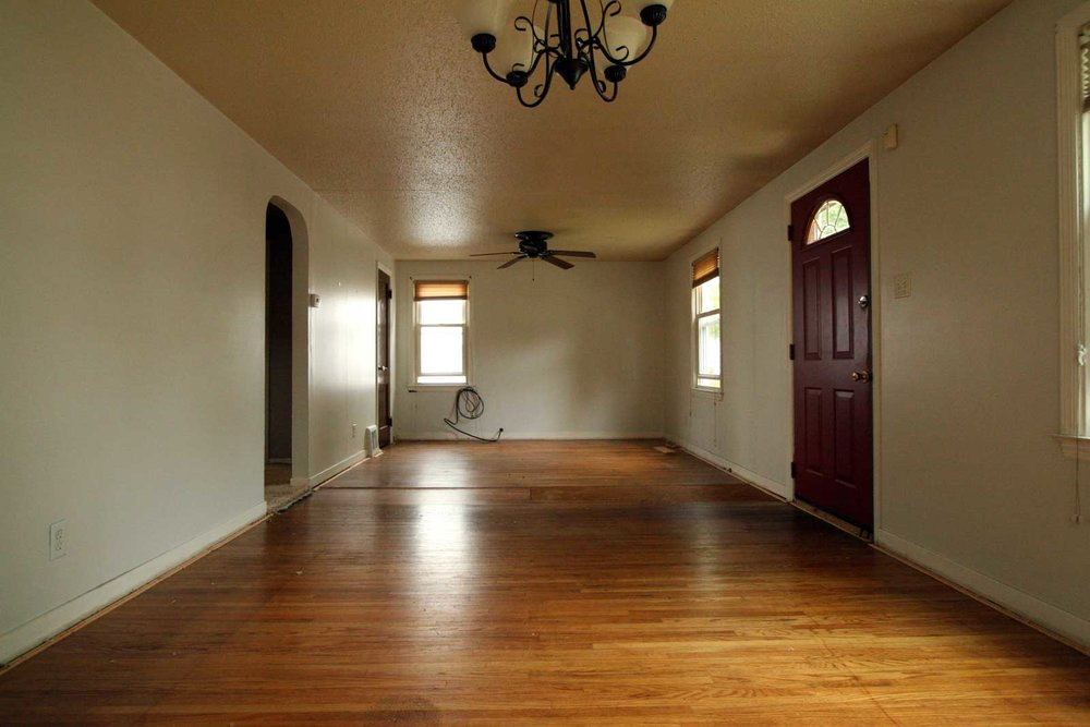 Living/dining space - wood floors under carpet