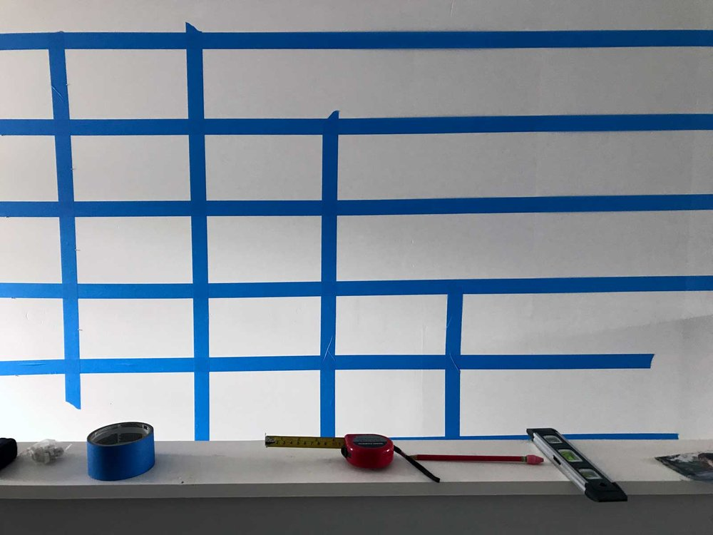 Photo Wall Taping a Grid