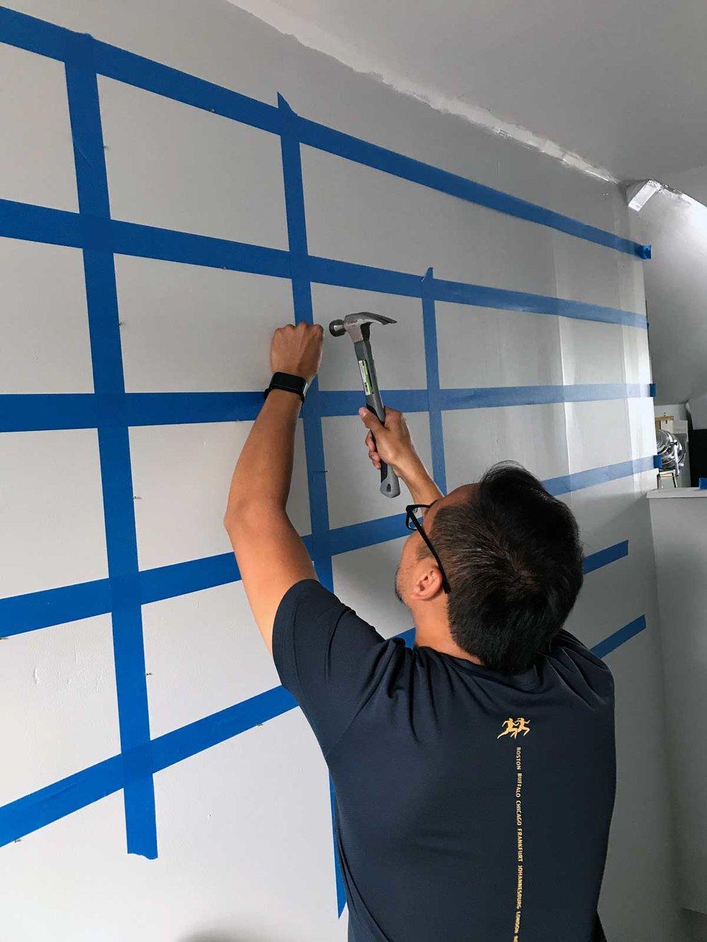 Photo Wall Hammering Nails