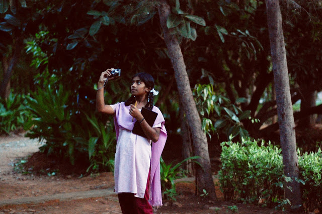 Student with a camera - taken by a student.See more photos