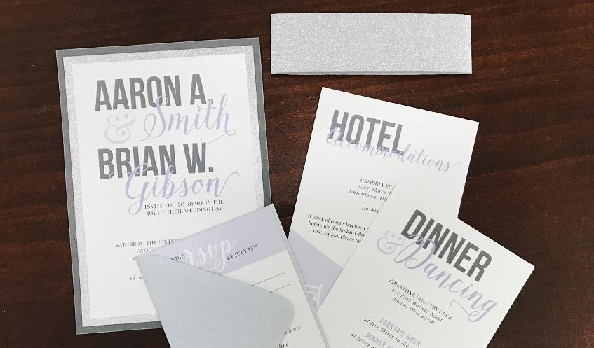 A glitter layer and belly band, paired with shimmer paper, make this invitation pop!