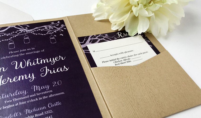 Texture instantly adds elegance to any invitation suite. Here, we used a textured wood-grain folder to stay true to the rustic theme of the wedding.